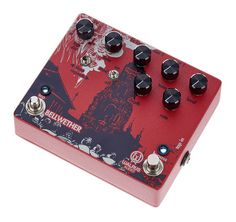 Black & white graphics on a red background, black metal knobs
