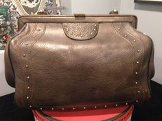 A personal favorite from my Etsy shop https://www.etsy.com/listing/208622666/vintage-leather-sachel-bag-brass