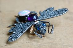 Incredible turn-of-the-century Russian insect brooch, depicting a Virgin Queen flying ant, winged for her nuptial flight.