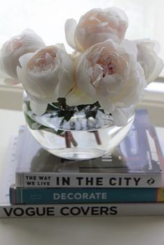 My favorite... Simple vase of peonies resting on beautiful coffee table books. Lovely.