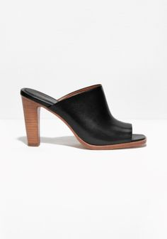 &OTHER STORIES Streamline shape and superb leather quality define these sleek open-toe mules set atop a contrasting stacked leather heel.