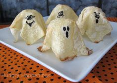 Sweet Ghost Crisps (makes 12)    Ingredients:    12 egg roll wrappers  black edible food marker  egg wash - 1 egg mixed with 1 teaspoon water  1/2-2/3 cup granulated sugar    Special Equipment Needed:    parchment paper or tin foil  muffin tins/cupcake pans
