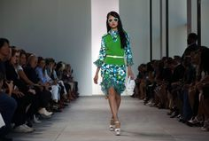 """PANTONE COLOR 2017 1-184 A look from the Michael Kors spring 2017 collection during New York Fashion Week in September. For its 2017 """"Color of the Year,"""" the Pantone Color Institute chose greenery, more specifically, Pantone 15-0343, a """"yellow-green shade that evokes the first days of spring."""" Kors is one of many designers to recently feature similar shades on the runway."""