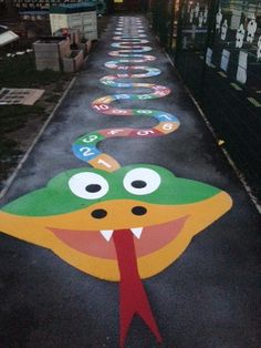 This playground marking can make imaginative play both fun and educational. The 4 Point Compass is approximately metres in size. This bright and colourful marking is made to provide multiple educational benefits.Giant Headed Snake Markings By ThermmarkOne Playground Painting, Playground Games, Outdoor Learning Spaces, Vie Motivation, Kindergarten Design, School Hallways, School Painting, Floor Stickers, Kids Play Area