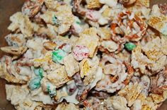 White Trash: 4 c rice chex, 4 c corn chex, 3/4 bag pretzels, 1 bag red & green m&m's, 1 can mixed nuts, 1 can cashews, 2 pkg. white chocolate almond bark