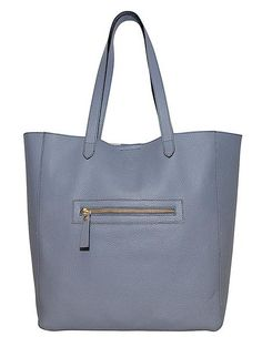 Ash Tote Bag: Other colours available Made from luxurious Italian leather and lined in suede, the Covet Tote is perfect for carrying all your daily essentials. There is a generous central section, with plenty space for a laptop and papers, as well as a zipped internal pocket and two slip pockets to keep you organised. The additional external zipped pocket is perfect for keeping your phone and other essentials handy. magnetic closure 1 external zipped pocket 1 internal zipped pocket 2…