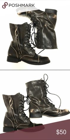 Aldo combat boots Distressed looking combat boots in a brown/black color with tan suede lining. Lace up with zipper detail on outer sides. Very versatile boots that look good with pants, shorts, or dresses. The color goes well with everything. Perfect for fall! In great condition. Aldo Shoes Combat & Moto Boots
