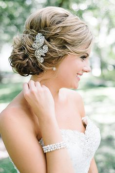 Tara dressed up her updo with a clip from The White Closet Bridal for her plantation wedding in South Carolina.