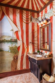Powder bathrooms should have a personality all their own and this one certainly does as it shows off the homeowners fun spirit and love of dogs.  Design by By Design Interiors