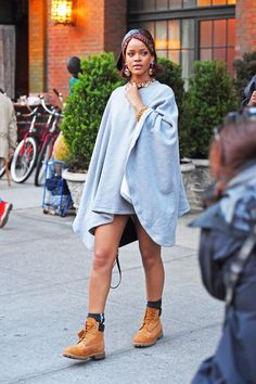 12 Times Rihanna Was The Queen Of NYC Summer Style #refinery29  http://www.refinery29.com/rihanna-nyc-summer-style#slide-10  The solution to wearing your favorite poncho in the dead of summer? Leave your pants at home and accessorize like it's nobody's business. Louis Vuitton bag; Vianel hat....