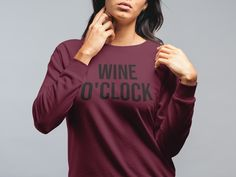 A sturdy and warm sweatshirt bound to keep you warm in the colder months. A pre-shrunk, classic fit sweater that's made with air-jet spun yarn for a soft feel and reduced pilling. Wine O Clock, Oclock, Online Boutiques, Rib Knit, Crew Neck Sweatshirt, Graphic Tees, Unisex, Sweatshirts, Sweaters
