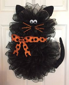 Handmade Halloween Deco Mesh Cat Wreath Made with a wire wreath, chenille stems, deco mesh, ribbon, cat ears, googly eyes, chenille stems, and a Pom-pom. Deco Mesh includes: Black Ribbon includes: Orange Polka Dot/Purple polka dot (You choose) Eyes are plastic googly eyes. Nose is made with with a Pom pom. Whiskers are made with Chenille Stems. Measures approx. 22 H x 18 W x 7 D Free Shipping!!! I will ship item within 48 hours of CLEARED payment. I use USPS ground shipping unless p...