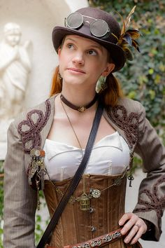 Simple, smart look for Steampunk.  Particularly like the bolero and extended chain clasp.  Gaslight Gathering 2013 by Mr. Muggles, via Flickr