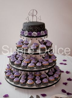 Purple and black wedding cupcake tower, this is what I want.