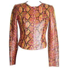 Guaranteed authentic CHANEL 00T python jacket in vibrant shades of rose, orange, mustard and brown.... available mightychic.com