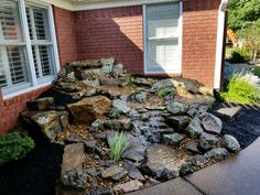 A new Pondless Waterfall is born! This one fit perfectly into this small area by the back patio. Views from inside & out in Humboldt, Tn. Designed & built by Carters Nursery Pond & Patio