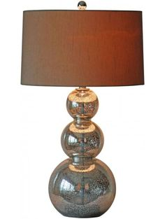 Perla Silver Table Lamp. The mercury glass finish and faux silk shade will add instant elegance to any space.