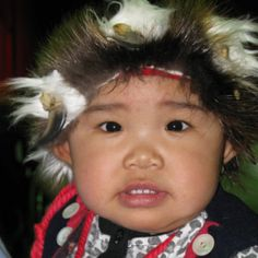 Native Alaskan Child in regalia. Their history and culture is so important to the people...