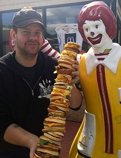 McDonald's 'McEverything': Man Creates Monster Sandwich (and survives) from all 43 varieties which is 4 feet high and cost $141.33 to make...