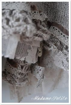 Restyling ideas: edges of original sweater extended with hand crochet, plus velvet ribbon, cotton crochet trim, lace design netted sheer material w raw edge