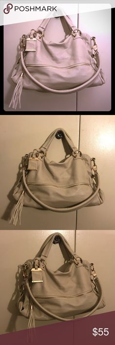 IVORY/VANILLA FAUX LEATHER SATCHEL BAG W/ GOLD Gently worn! Normal wear/marks noted on the bottom of the bag otherwise in excellent condition! This a very versatile day-to-night bag! It comes with 2 detachable straps intended to be worn as a short-shoulder, long-shoulder and cross-body bag! A dust cover is also included for protection. Color: Vanilla/Ivory with gold hardware.  💥 Also, selling this in brown. Check out my closet! Bags Satchels
