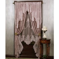 The roses in garden are enchanting when viewed through pink lace curtains.