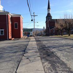 Presbyterian Church on the right. Former grade school on the left.