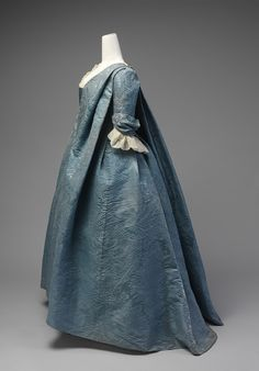 Robe volante 1730s: This robe volante is an exceedingly rare example of a well-documented form of dress that marked the transition from the mantua of the late seventeenth and early eighteenth centuries to the robe à la française, the dress style that became ubiquitous in the eighteenth century. The unstructured silhouette of the robe volante, with its unbroken expanses of cloth, made it particularly appropriate for the display of large-scale patterning.