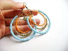 orange and blue beaded earrings