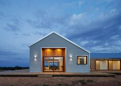 This shed-inspired house in Australia features a low-maintenance fire-resistant facade of corrugated steel that also helps to reflect heat