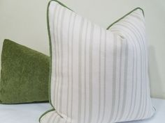 Sage Green ivory striped indoor/ outdoor pillow cover. It is made from sunbrella…