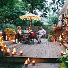 terra cotta pots, sand and white candles for outdoor lighting