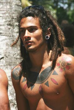 Guy with dreads and Tattoos