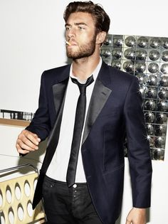 Men's navy blazer, white shirt, black skinny tie and black denim jeans.