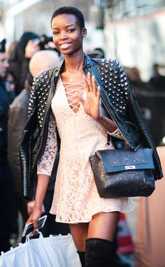 Maria Borges from Victoria's Secret Models Off-Duty Style  A lace dress with a studded leather jacket? It's femininity meets masculinity at its best.