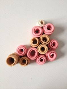 Pink, tan and pearl rolled tube sculpture, medium sculpture of polymer clay, neutral decor, gathering of thirteen clay tubes