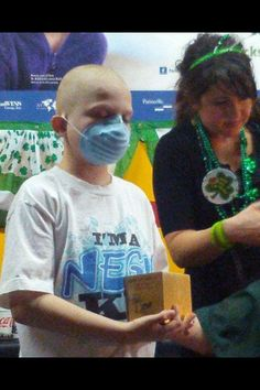 """From Mark Kelly's Mother on March 21st: """"This is a picture of Mark Kelly last march at a childhood cancer research fundraiser holding the urn of his dear friend, AJ Fuller. Please pray for all warriors fighting the cancer beast, other chronic illnesses and the families. Thanks for the prayers. Go Team Mark Kelly!""""  https://www.facebook.com/TeamMarkKelly  #endchildhoodcancer #gogold"""