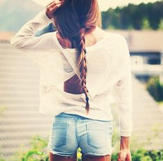 Light knit long sleeve with a cutout in the back paired over denim shorts.