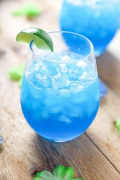 Blue Curacao is a must have in my liquor cabinet. It has a mild citrus flavor, and gorgeous blue color! I love using it in my blue lagoons and blue Hawaiians . It also goes great in these blue margaritas. Blue Drinks, Summer Drinks, Cocktail Drinks, Mixed Drinks, Alcoholic Drinks, Cocktail Shaker, Blue Curacao Drinks, Beverages, Liquor Drinks