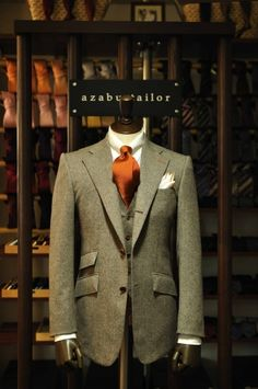 Country suit with ticket pocket from azabu tailor. Burnt orange tie gives a youthful twist. Would look cracking with a light blue shirt.