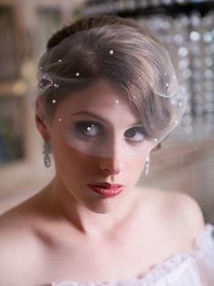 I wore a long veil, edged in lace - with a blusher, at my wedding...and I loved it.  But I'm going for something different here: a fine mesh birdcage veil.