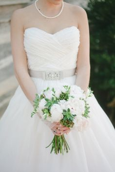 We're dying over the belts on wedding gowns now! Just so beautiful!   Gown by Reem Acra, Photography by jnicholsphoto.com, Flowers by sproutflowers.com