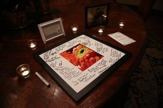 Guests sign commemorative frame instead of a guest book at sign-in table | One Fine Day Photography | villasiena.cc