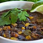 Mexican Black Bean Corn Soup  I make this all the time; although, I modify the recipe a bit. I use 3 cans of tomatoes and 4 cups of veggie broth (1 container). Also you MUST add cinnamon, tastes much better!