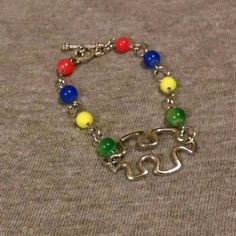 Check out this item in my Etsy shop https://www.etsy.com/listing/272580340/autism-awareness-bracelet