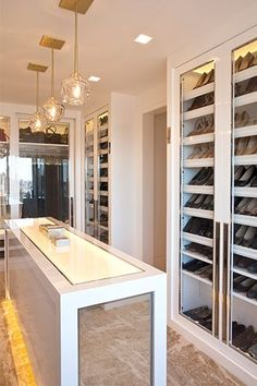 Fabulous walk-in closet design with gray cabinets filled with designer bags and shoes as well as gray closet island with glass-top to easily view jewelry collection. Dressing Room Closet, Dressing Room Design, Closet Bedroom, Dressing Rooms, Master Bedroom, Master Closet, Walk In Closet Design, Closet Designs, Closet Island