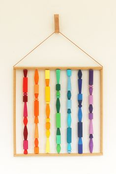 A colorful rainbow wall hanging to instantly create a happy corner. This fun boho wall art decor is an amalgam of beads in diverse colors, shapes and sizes. Rainbow Magic, Rainbow Wall, Lesbian Gifts, Boho Wall Hanging, Metallic Paper, Paper Jewelry, Little Gifts, Wall Art Decor, Nest