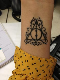 Love it! Cute way to make a Harry Potter tattoo seem inconspicuous. Deathly Hallows tattoo.