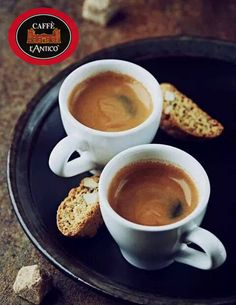 Photo about Two cups of espresso with cantuccini on a dark ceramic plate. Image of black, plate, cantuccini - 29808538 Best Espresso, Espresso Coffee, Coffee Cafe, My Coffee, Coffee Drinks, Best Coffee, Coffee Barista, Black Coffee, Coffee Mugs