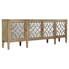 """4-door mirrored console with a fretwork motif. $1758 Product: Console Construction Material: Hardwood solids, oak veneers and mirrored glass Color: Natural Features: Distressed finish Four doors Fretwork motif Dimensions: 38"""" H x 105"""" W x 20"""" D"""